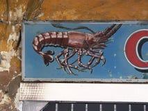小龙虾的描述在标志的 免版税库存图片