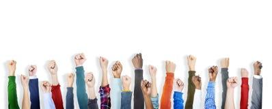 小组不同的人民的握紧拳头 图库摄影