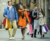 小组与购物袋的成人 免版税库存图片
