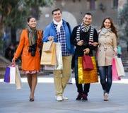 小组与购物袋的成人 免版税库存照片