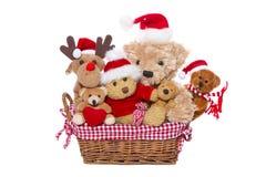 小组为红色圣诞节装饰隔绝的玩具熊-骗局 免版税库存照片