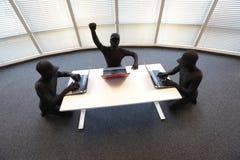 小组匿名黑客与计算机一起使用在办公室 免版税库存照片