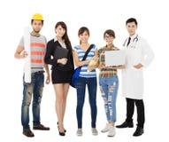 小组另外职业站立的不同的青年人 免版税库存照片