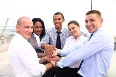 小组商人加入手或团结了 库存照片