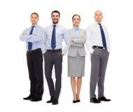 小组在白色背景的微笑的商人 免版税图库摄影
