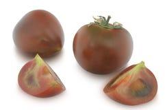 小组在白色背景隔绝的Kumato蕃茄 免版税库存图片