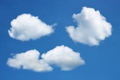 小组在蓝天的白色云彩 库存图片