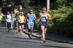小组在路的赛跑者(饥饿跑2014年, FAO/WFP) 图库摄影