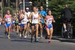 小组在路的赛跑者(饥饿跑2014年, FAO/WFP) 免版税库存照片