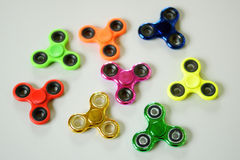 小组坐立不安锭床工人五颜六色应力消除的玩具 免版税库存照片