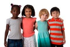 小组多种族孩子画象在演播室 查出 免版税库存照片
