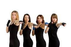 小组妇女被隔绝在白色制造的tae bo 免版税库存图片