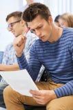小组学生在教室 免版税图库摄影
