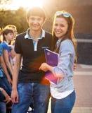 小组学生或少年有笔记本的 库存图片