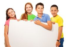 小组孩子展示标志 免版税库存图片