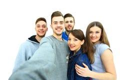 小组愉快的年轻少年学生 免版税图库摄影