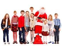小组有圣诞老人的孩子。 免版税库存照片