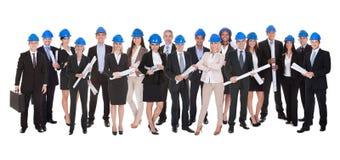 小组有方案的建筑师 免版税库存图片