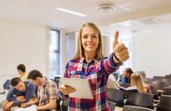 小组有片剂个人计算机的微笑的学生 免版税库存图片