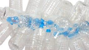 小组有蓝色焰晕的透明塑料空的瓶栓与红色绳索 库存图片