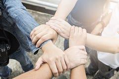 小组朋友用在堆的手,配合 免版税库存图片