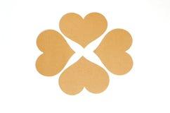 小组棕色心脏标记,做从回收纸 库存照片