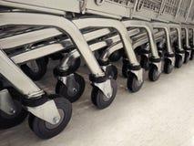 小组购物车在白色地板上的台车轮子 库存图片
