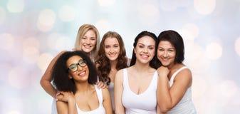 小组白色内衣的愉快的不同的妇女 库存照片