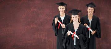 小组的综合图象庆祝在毕业以后的少年 免版税库存照片