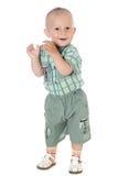 小滑稽的男婴站立并且微笑白色背景 库存图片