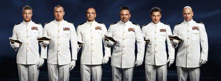小组6英俊的上尉 免版税图库摄影