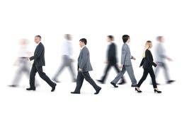 小组走用不同的方向的商人 免版税库存图片