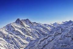 少女峰山土坎直升机视图在冬天 免版税图库摄影