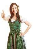 少女装礼服的微笑的妇女 免版税库存图片
