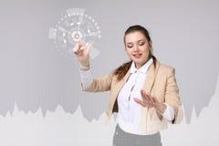 少妇与图表图一起使用 busines的,股市概念未来技术 免版税图库摄影