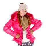 少妇佩带的冬天夹克围巾和盖帽 免版税库存图片