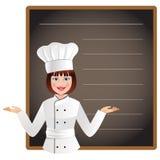 少妇厨师以列出今天菜单的一个空白的黑板 免版税库存图片