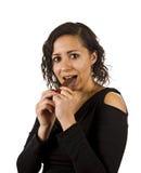 少妇吃巧克力 库存照片