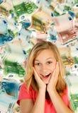 少妇和很多金钱 免版税库存图片
