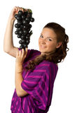 少妇和葡萄 库存图片