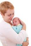 少妇在现有量抱着她新出生的婴孩 库存图片