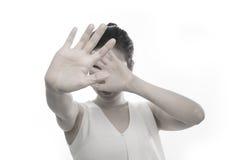 少妇在被隔绝的白色backgroun的培养手 免版税库存照片