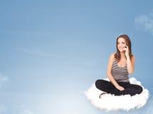 少妇坐与拷贝空间的云彩 免版税库存照片