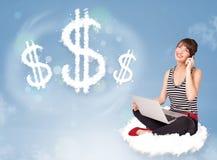 少妇坐云彩在云彩美元的符号旁边 免版税库存图片