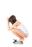 少妇坐她的在等级的腰臀部分 库存图片