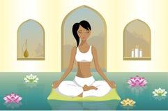 少妇实践的瑜伽 免版税库存图片