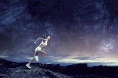 少妇慢跑者 免版税库存图片