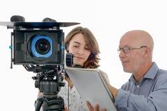 少妇摄影师和成熟人 免版税库存照片
