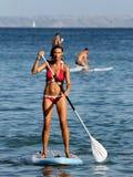 少妇桨搭乘 免版税库存照片