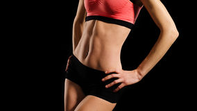 少妇的运动的腹部 库存图片